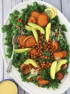 Kale Salad with roasted sweet potatoes, crispy chick peas and avocado with a creamy tahini dressing