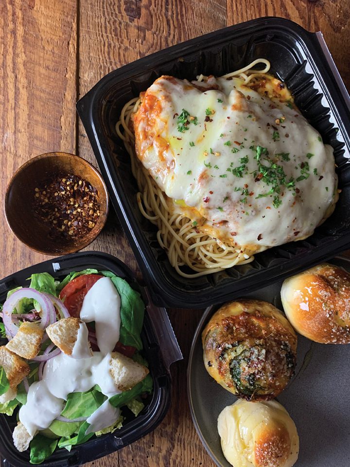Take-out Chicken Parmesan, house salad and garlic rollls from Anne Marie's in Pompano Beach